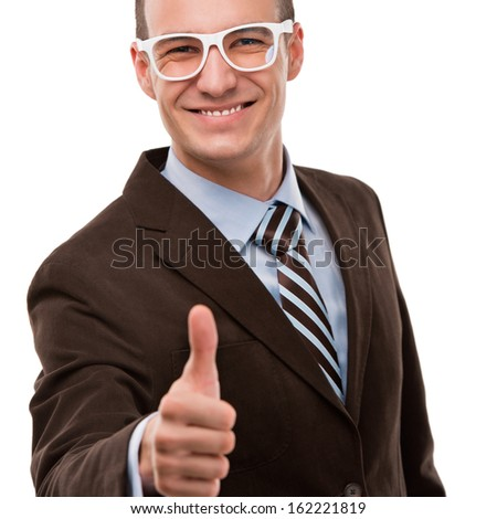 Portrait of a joyful young businessman gesturing thumb up sign over isolated white background - stock photo