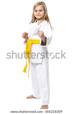 Portrait of a karate girl in kimono with yellow belt ready to fight isolated on white background - stock photo