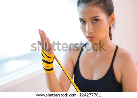 Portrait of a kickboxing fighter with an intense look - stock photo