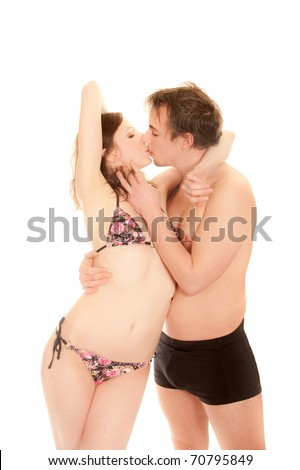 Portrait of a kissing young couple in swimwear - stock photo