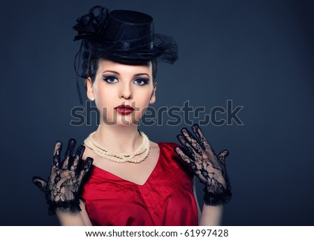 Portrait of a lady in a retro hat with beads and lace gloves. Cross processing - stock photo