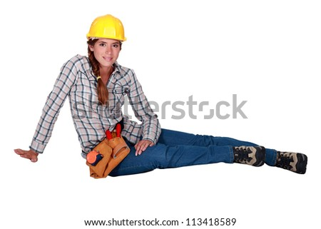 Portrait of a laid-back tradeswoman - stock photo