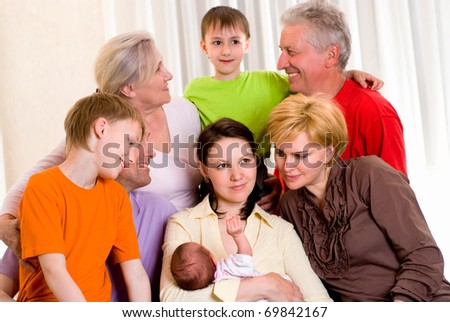 portrait of a large family on a light background - stock photo