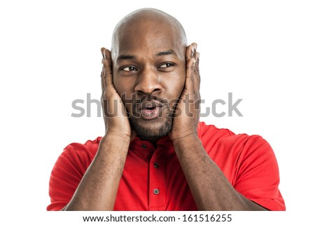Portrait of a late 20s handsome black man covering ears isolated on white background