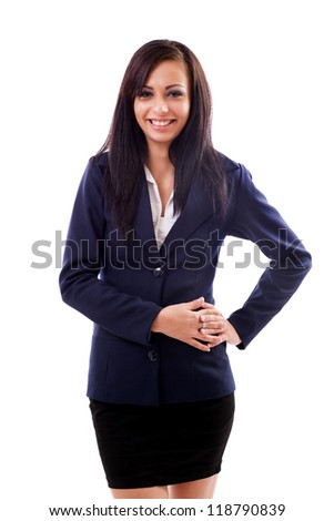 Portrait of a latin businesswoman standing with hand on hip isolated on white background - stock photo