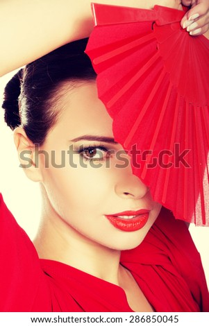 Portrait of a latino dancer wearing red dress.