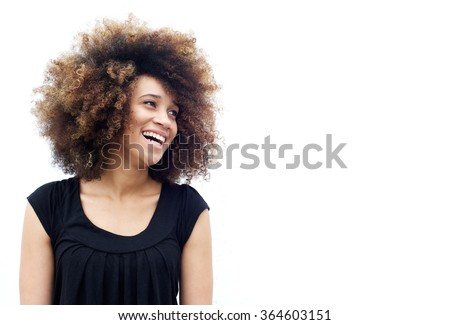 Portrait of a laughing african american woman looking away - stock photo