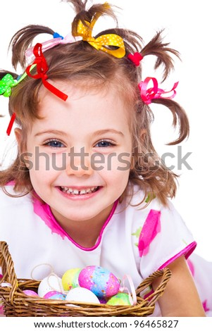 Portrait of a laughing girl with colorful ribbons in hair - stock photo