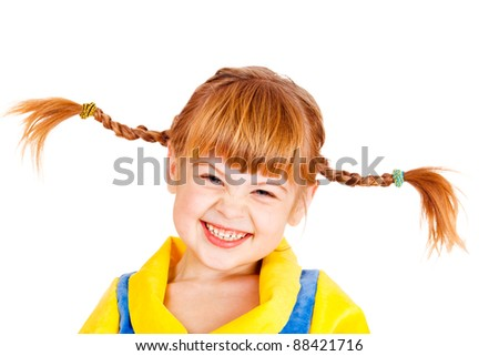 Portrait of a laughing girl with funny braids - stock photo