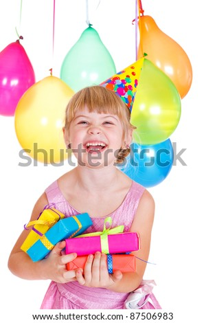 Portrait of a laughing kid with birthday presents in hands - stock photo