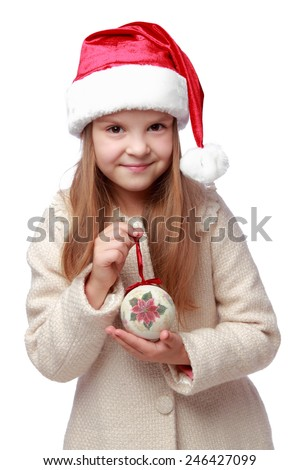 Portrait of a laughing little girl in Santa hat - stock photo