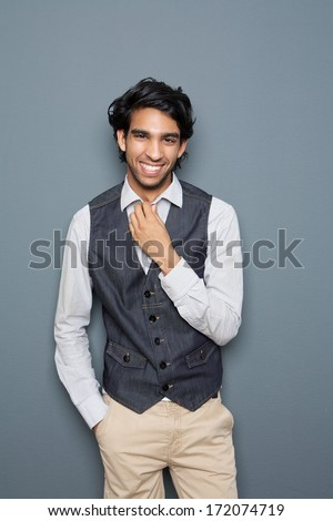 Portrait of a laughing man standing against fray background - stock photo