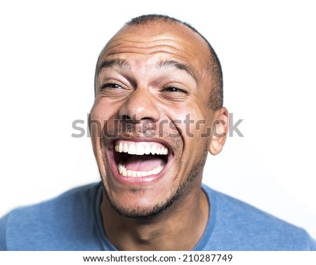 Portrait of a laughing mixed race man - stock photo