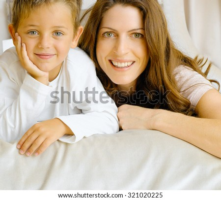 portrait of a laughing young mother and her pretty son  - stock photo