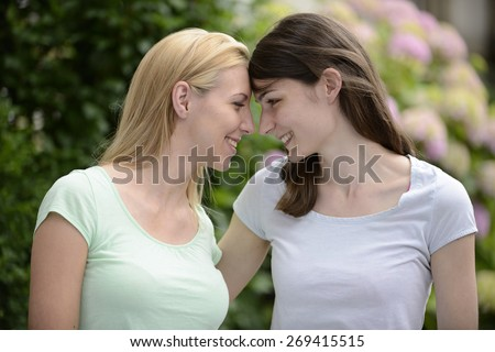 Portrait of a lesbian couple outdoors - stock photo