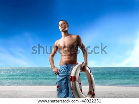 Portrait of a life guard carrying a lifesaver - stock photo