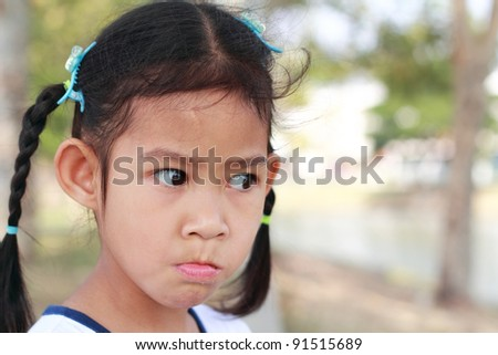 Portrait of a little Asian child girl is looking - stock photo