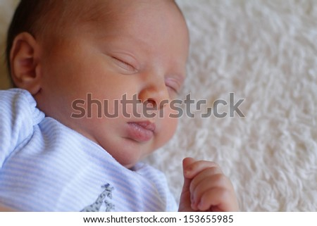 Portrait of a little baby boy sleeping peacefully