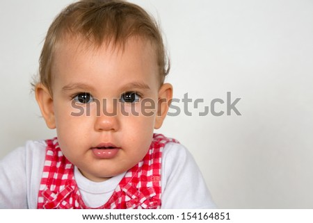 Portrait of a little baby, looking into camera