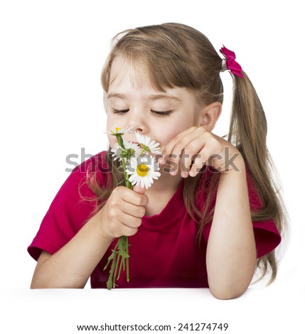 Portrait of a little blond girl with a bouquet of camomiles on the white - stock photo