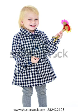 Portrait of a little blonde girl in a checkered coat and flowers in hand- isolated on white background - stock photo