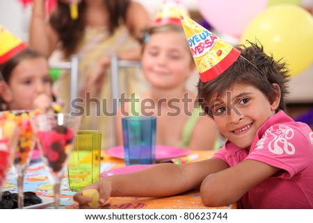 portrait of a little boy at a birthday party - stock photo