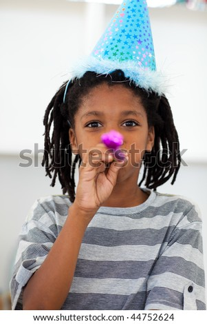 Portrait of a little boy at a birthday party at home - stock photo