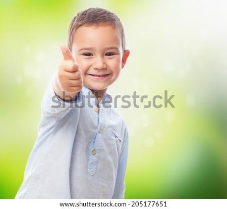 portrait of a little boy doing okay gesture - stock photo