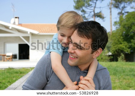 Portrait of a little boy embracing a man - stock photo