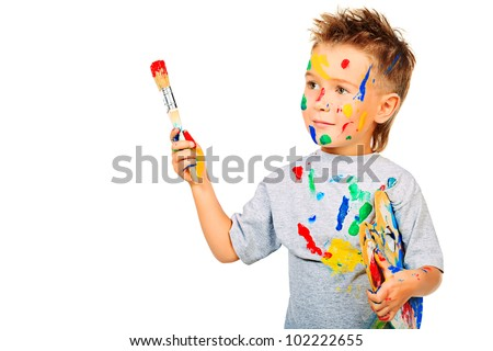 Portrait of a little boy enjoying his painting. Education. Isolated over white background. - stock photo