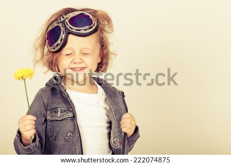 portrait of a little boy in a denim jacket - stock photo