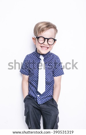 Portrait of a little boy in a funny glasses and tie. School. Preschool. Fashion. Studio portrait isolated over white background - stock photo