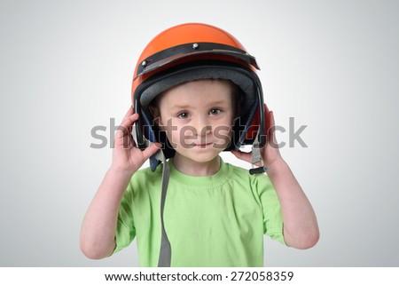 Portrait of a little boy in a motorcycle helmet - stock photo