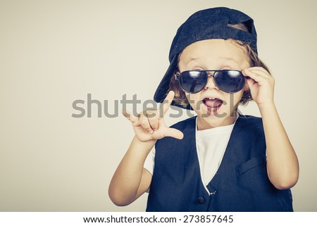 portrait of a little boy in studio - stock photo