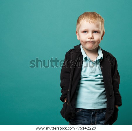 portrait of a little boy on a green background. - stock photo