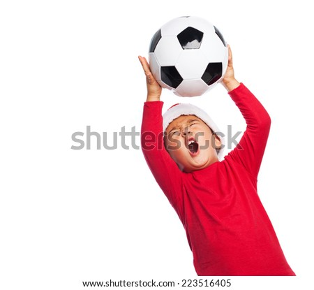 portrait of a little boy playing football - stock photo