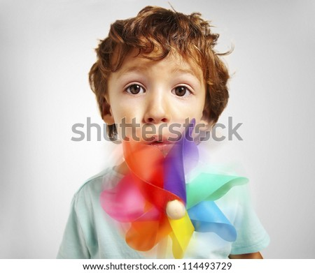 portrait of a little boy playing over isolated background - stock photo
