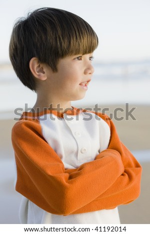 Portrait of a Little Boy Standing at The Beach