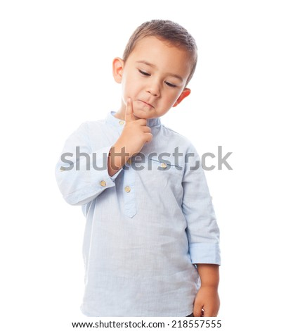 portrait of a little boy thinking and serious - stock photo
