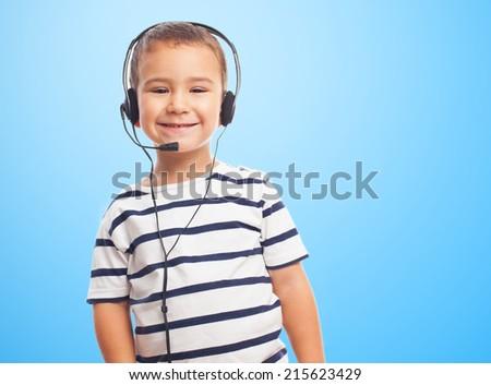 portrait of a little boy using a headset - stock photo
