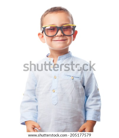 portrait of a little boy wearing retro sunglasses
