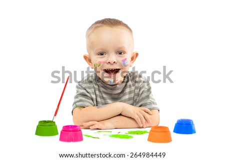 portrait of a little boy with colored inks and colored hands showing. portrait isolated on white background.