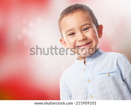 portrait of a little boy with smiling gesture