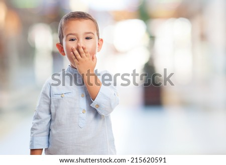 portrait of a little boy with surprised gesture - stock photo