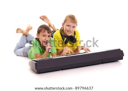 portrait of a little boys at sintezator - stock photo
