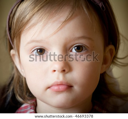 Portrait of a little delicate girl with bow knot on head