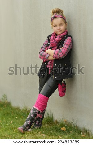 Portrait of a little fashion girl outdoors - stock photo