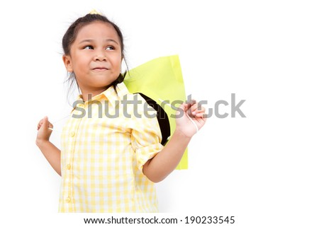 Portrait of a little fashion shopping girl with shopping bags, isolated over white