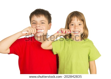 Portrait of a little girl and a young boy brushing teeth - stock photo
