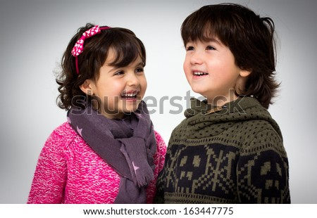 portrait of a little girl and boy - stock photo